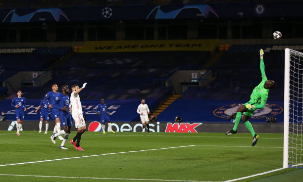 Edouard Mendy of Chelsea makes a save from Karim Benzema of Real Madrid during the UEFA Champions League Semi Final Second Leg match between Chelsea...