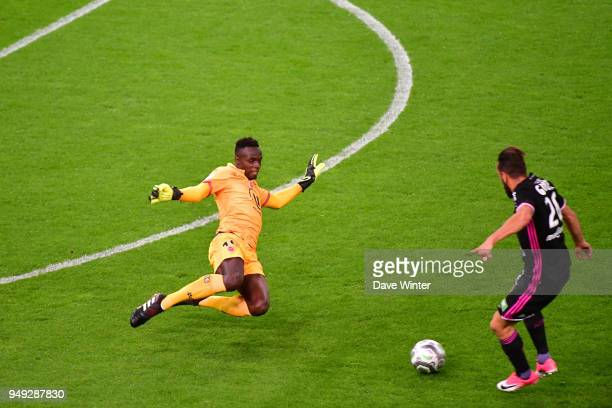 Edouard Mendy of Reims comes out to clear from Ghislain Gimbert of AC Ajaccio during the French Ligue 2 match between Reims and Ajaccio at Stade...