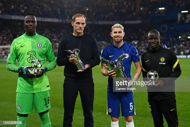 Edouard Mendy, Thomas Tuchel, Manager of Chelsea, Jorginho and Ngole Kante of chelsea pose for a photo with their respective awards for their...