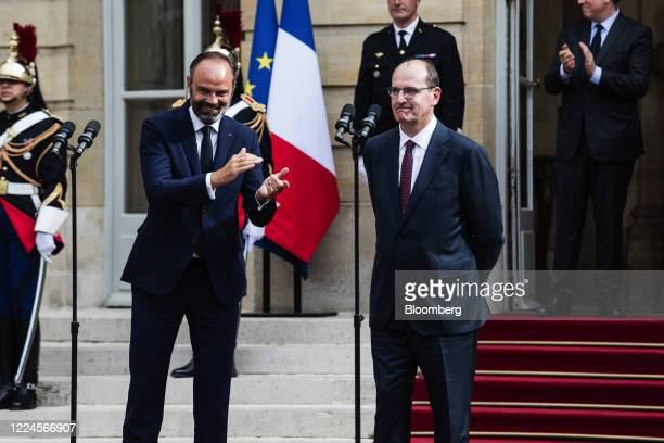 Edouard Philippe France's former prime minister left applauds beside Jean Castex Frances new prime minister during a handover ceremony at the Hotel...