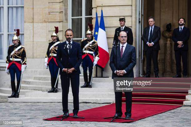 Edouard Philippe France's former prime minister left delivers a speech beside Jean Castex Frances new prime minister during a handover ceremony at...