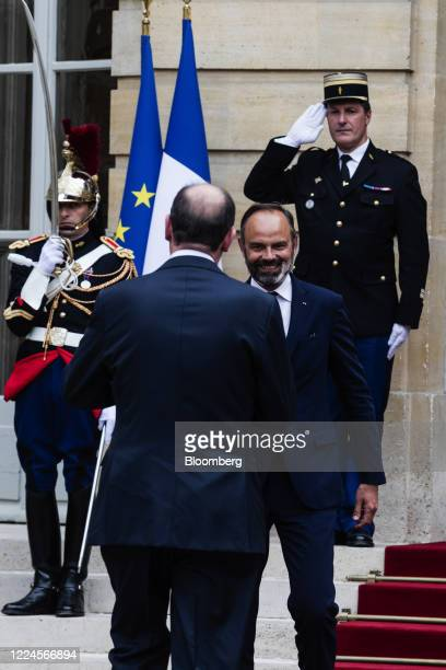 Edouard Philippe France's former prime minister right greets Jean Castex Frances new prime minister ahead of a handover ceremony at the Hotel de...