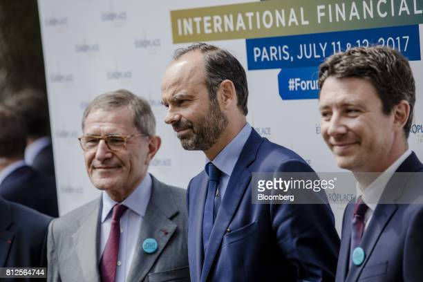 Edouard Philippe France's prime minister center stands between Gerard Mestrallet chairman of Paris Europlace and Engie SA left and Benjamin Griveaux...