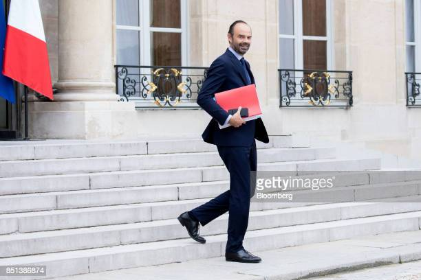 Edouard Philippe France's prime minister departs following a cabinet meeting to approve labor law reforms at the Elysee Palace in Paris France on...