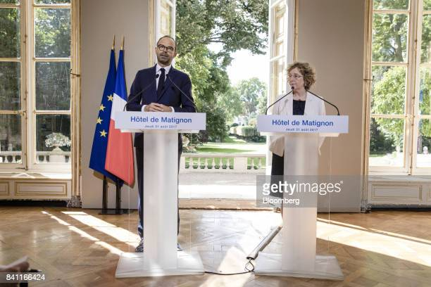 Edouard Philippe France's prime minister left speaks as Muriel Penicaud France's minister for labour looks on during a news conference in Paris...