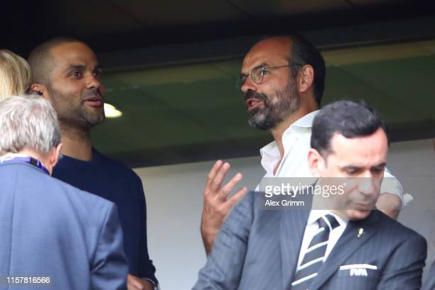 Edouard Philippe Prime Minister of France talks to Tony Parker prior to the 2019 FIFA Women's World Cup France Round Of 16 match between France and...