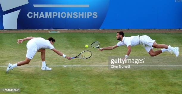 Edouard Roger-Vasselin of France and Benoit Paire of France in action during the Men's Doubles second round match against Colin Fleming of Great...