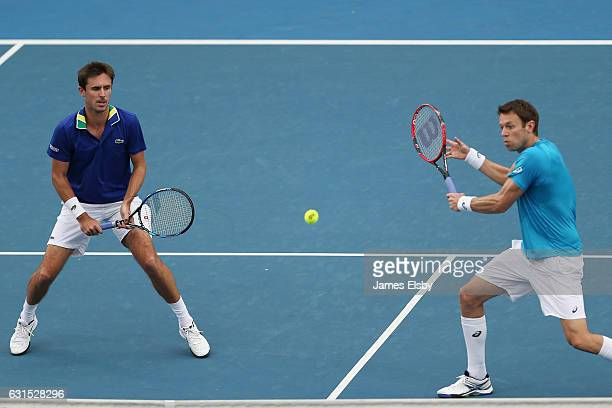 Edouard RogerVasselin of France and Daniel Nestor of Canada compete during their World Tennis Challenge match against John Peers of Australia and...