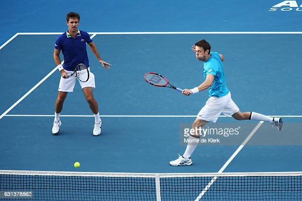 Edouard RogerVasselin of France and Daniel Nestor of Canada competes during day one of the 2017 World Tennis Challenge at Memorial Drive on January...
