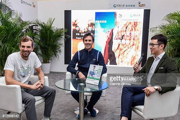 Edouard RogerVasselin of France and Julien Benneteau of France give an interview at the China Life booth during day four of the 2016 China Open at...