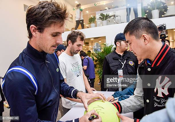 Edouard RogerVasselin of France and Julien Benneteau of France sign autographs at the China Life booth during day four of the 2016 China Open at the...