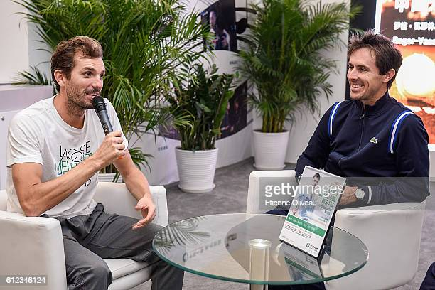 Edouard RogerVasselin of France and Julien Benneteau of France take an interview at the China Life booth during day four of the 2016 China Open at...