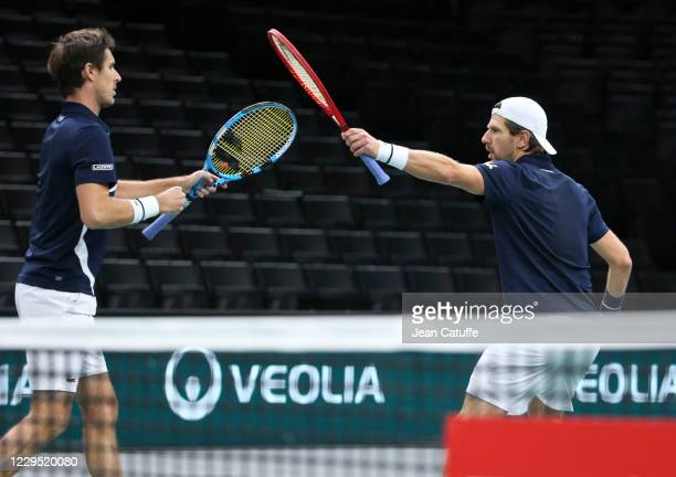 Edouard Roger-Vasselin of France and Jurgen Melzer of Austria celebrate during their semifinal on day 6 of the Rolex Paris Masters, an ATP Masters...