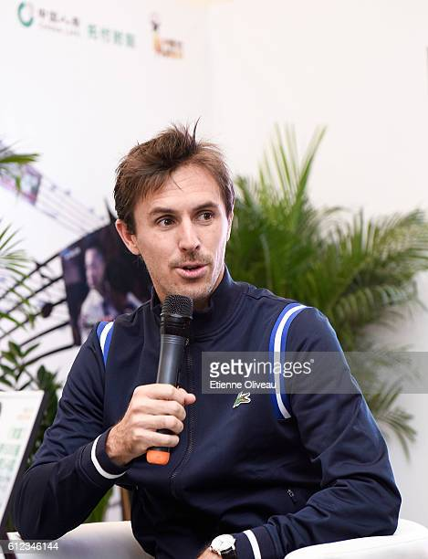 Edouard RogerVasselin of France gives an interview at the China Life booth during day four of the 2016 China Open at the China National Tennis Centre...