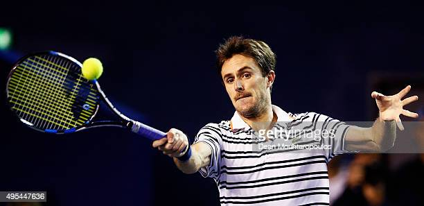 Edouard RogerVasselin of France in action against Ivo Karlovic of Croatia during Day 2 of the BNP Paribas Masters held at AccorHotels Arena on...
