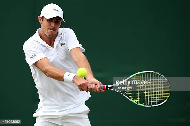 Edouard RogerVasselin of France plays a backhand during his Gentlemen's Singles first round match against Filippo Volandri of Italy on day one of the...