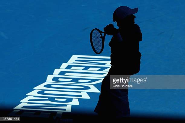 Edouard RogerVasselin of France plays a backhand in his second round match against Andy Murray of Great Britain during day four of the 2012...