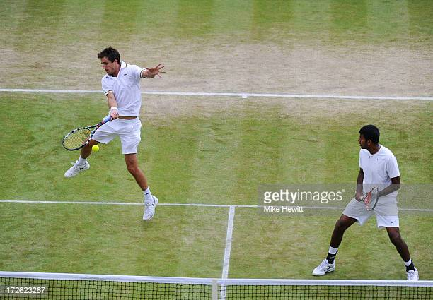 Edouard RogerVasselin of France plays a forehand next to teammate Rohan Bopanna of India during the Gentlemen's Doubles semi final match against Bob...