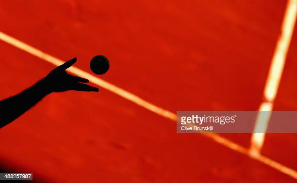 Edouard RogerVasselin of France serves against JoWilfried Tsonga of France in their first round match during day three of the Mutua Madrid Open...