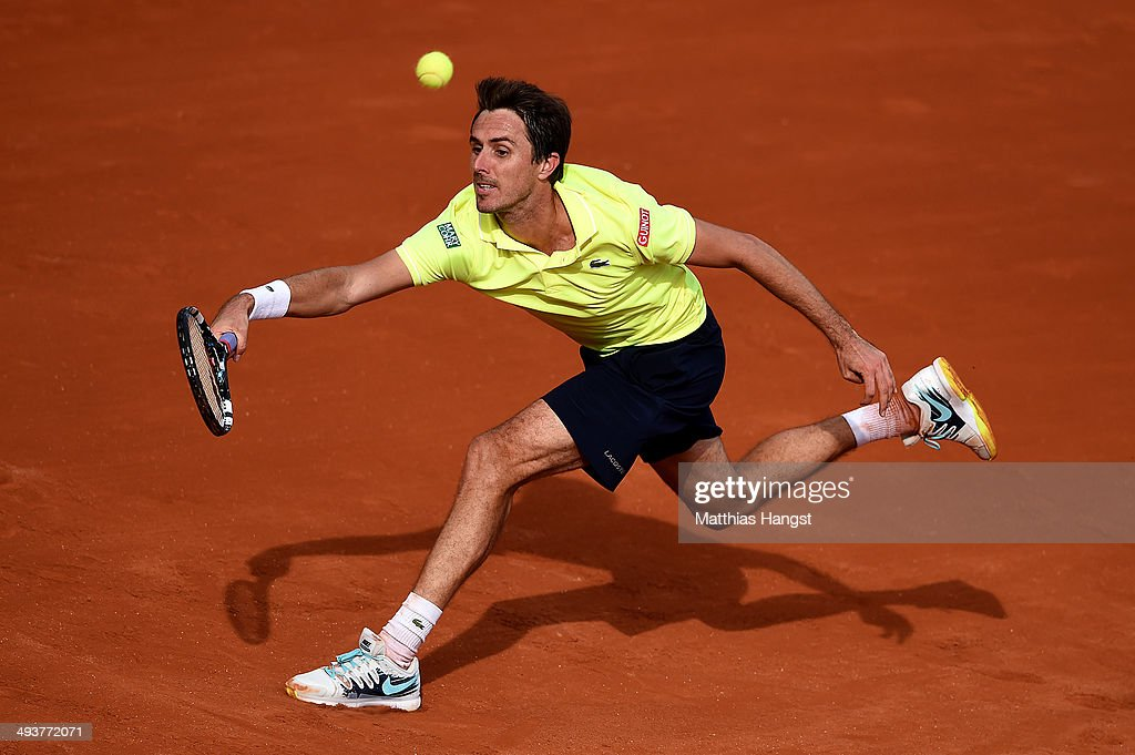 Edouard Roger-Vasselin of France serves during his men's singles match against Jo-Wilfried Tsonga of France on day one of the French Open at Roland Garros on May 25, 2014 in Paris, France.