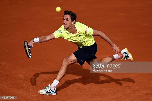 Edouard RogerVasselin of France serves during his men's singles match against JoWilfried Tsonga of France on day one of the French Open at Roland...