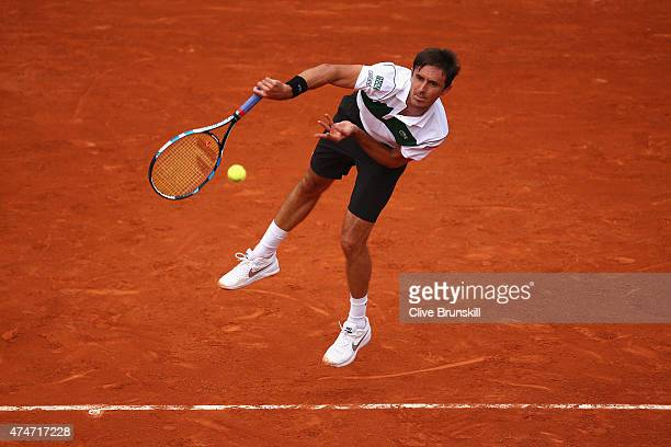 Edouard RogerVasselin of France serves in his Men's Singles match against Gael Monfils of France on day two of the 2015 French Open at Roland Garros...