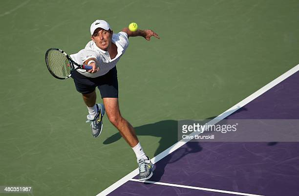 Edouard RogerVasselin of France stretches against Stanislas Wawrinka of Switzerland during their third round match during day 8 at the Sony Open at...