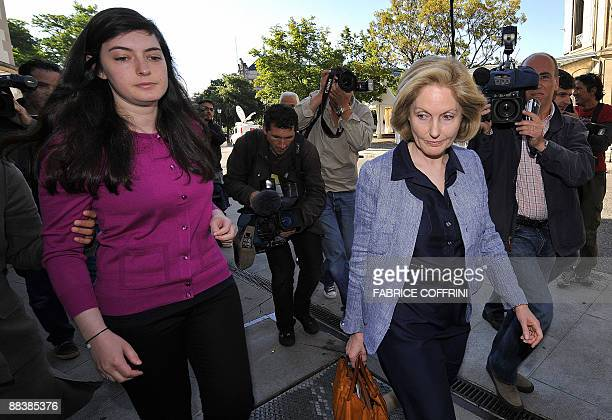 Edouard Stern's daughter Mathilde and Stern's former separated wife Beatrice arrive on June 10 2009 for the opening day of Cecile Brossard's trial in...