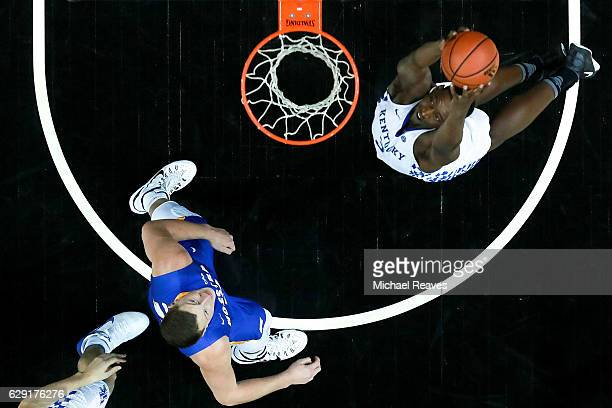 Edrice Adebayo of the Kentucky Wildcats catches a alleyoop pass against the Hofstra Pride in the second half of the Brooklyn Hoops Winter Festival at...