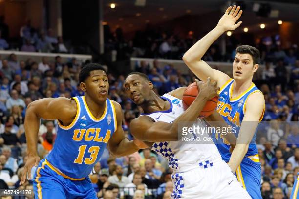 Edrice Adebayo of the Kentucky Wildcats handles the ball against Ike Anigbogu and Gyorgy Goloman of the UCLA Bruins in the first half during the 2017...
