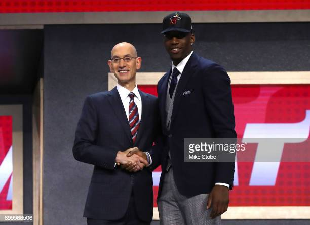 "Edrice ""Bam"" Adebayo walks on stage with NBA commissioner Adam Silver after being drafted 14th overall by the Miami Heat during the first round of..."