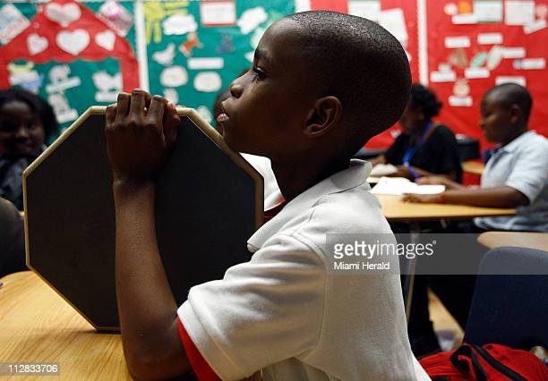Edrice Gerbier sits quietly with his drum pad waiting for practice to begin during the GOGO program at North Miami Middle School in the city of North...