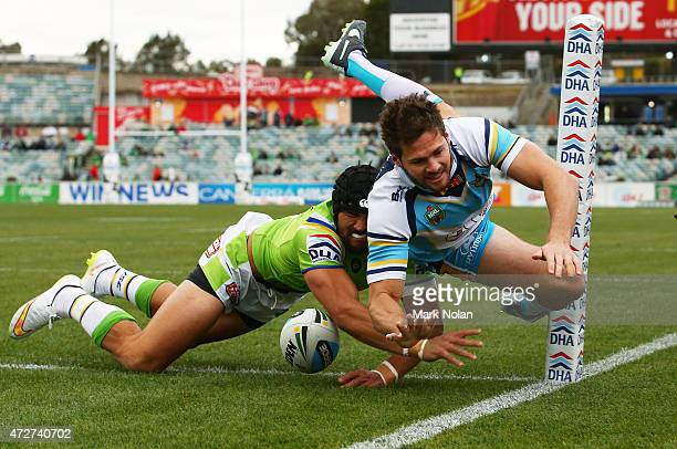 Edrick Lee of Raiders dives to score in the corner during the round nine NRL match between the Canberra Raiders and the GOld Coast Titans at GIO...