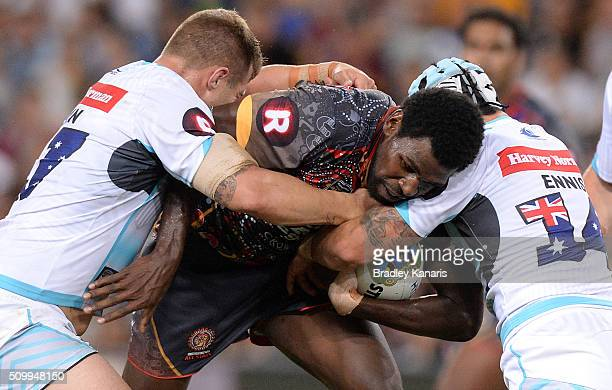 Edrick Lee of the Indigenous All Stars is tackled during the NRL match between the Indigenous AllStars and the World AllStars at Suncorp Stadium on...