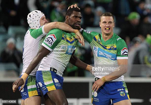 Edrick Lee of the Raiders is congratulated by team mates after scoring a try during the round 12 NRL match between the Canberra Raiders and the...