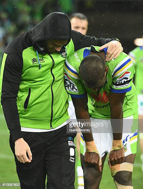 Edrick Lee of the Raiders is consoled by team mates after losing the NRL Preliminary Final match between the Melbourne Storm and the Canberra Raiders...