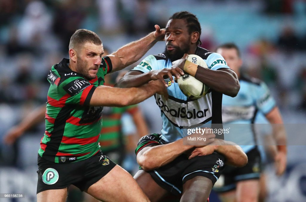 Edrick Lee of the Sharks is tackled by Robbie Farah of the Rabbitohs during the round 13 NRL match between the South Sydney Rabbitohs and the Cronulla Sharks at ANZ Stadium on June 1, 2018 in Sydney, Australia.