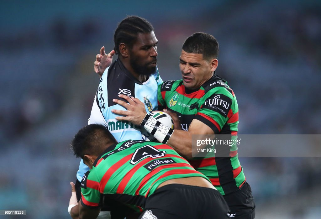 Edrick Lee of the Sharks is tackled during the round 13 NRL match between the South Sydney Rabbitohs and the Cronulla Sharks at ANZ Stadium on June 1, 2018 in Sydney, Australia.