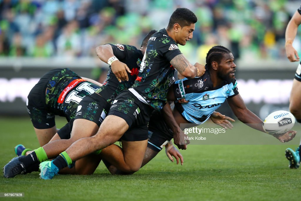 Edrick Lee of the Sharks passes as he is tackled during the round 10 NRL match between the Canberra Raiders and the Cronulla Sharks at GIO Stadium on May 13, 2018 in Canberra, Australia.