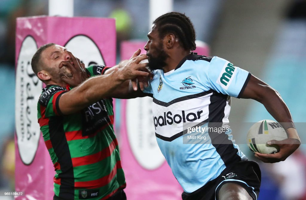 Edrick Lee of the Sharks puts a fend on Robbie Farah of the Rabbitohs during the round 13 NRL match between the South Sydney Rabbitohs and the Cronulla Sharks at ANZ Stadium on June 1, 2018 in Sydney, Australia.