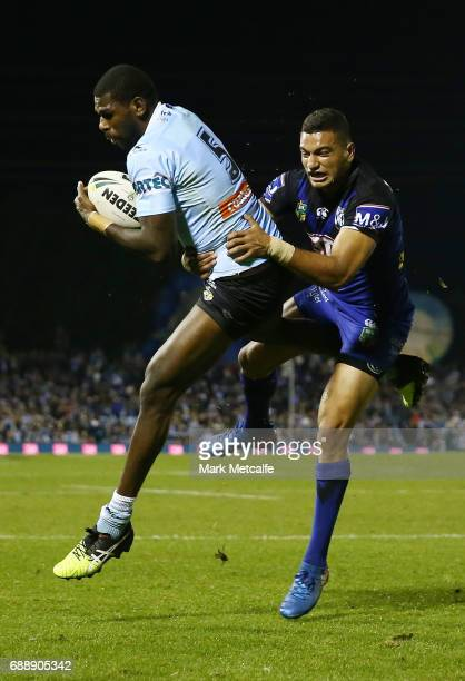 Edrick Lee of the Sharks takes a high ball ahead of Marcelo Montoya of the Bulldogs during the round 12 NRL match between the Cronulla Sharks and the...