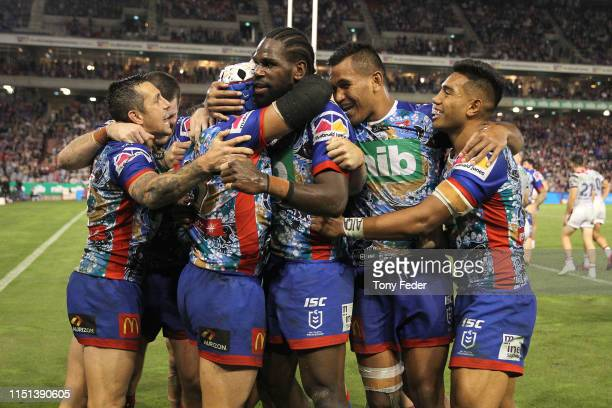 Edrick Lee of the Newcastle Knights celebrates a try with team mates during the round 11 NRL match between the Newcastle Knights and the Sydney...