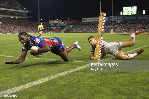 Edrick Lee of the Newcastle Knights scores a try during the round 11 NRL match between the Newcastle Knights and the Sydney Roosters at McDonald...