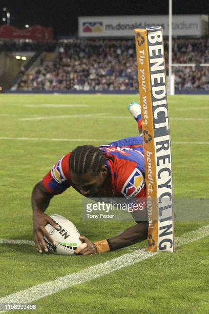 Edrick Lee of the Newcastle Knights scores a try during the round 15 NRL match between the Newcastle Knights and the Brisbane Broncos at McDonald...