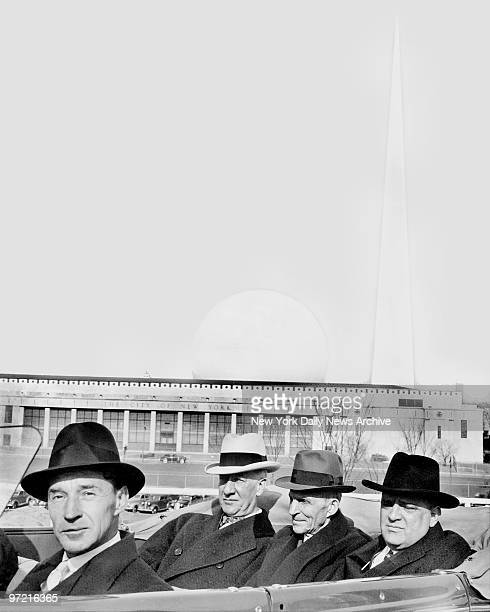 Edsel Ford , Al Smith, Henry Ford, and Mayor LaGuardia with the Trylon and Perisphere of the 1939 New York World's Fair in background