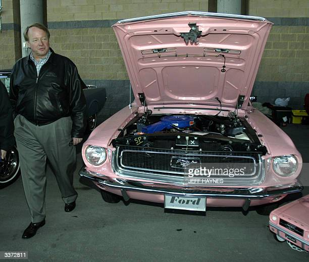 Edsel Ford II former president and chief operating officer of Ford Motor Credit Co walks around a 1968 Ford Mustang at the celebration of the 40th...