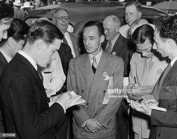 Edsel Ford , president of the Ford Motor Company, is interviewed by reporters on the company's 37th anniversary at the Ford exhibit at the World's...
