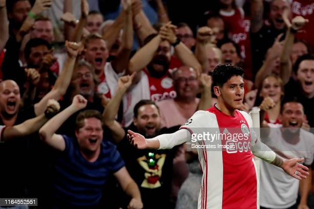 Edson Alvarez of Ajax celebrates 1-0 with Nico Tagliafico of Ajax during the UEFA Champions League match between Ajax v Apoel Nicosia at the Johan...