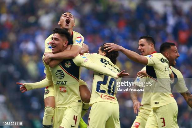 Edson Alvarez of America celebrates with teammates after scoring the first goal of his team during the final second leg match between Cruz Azul and...