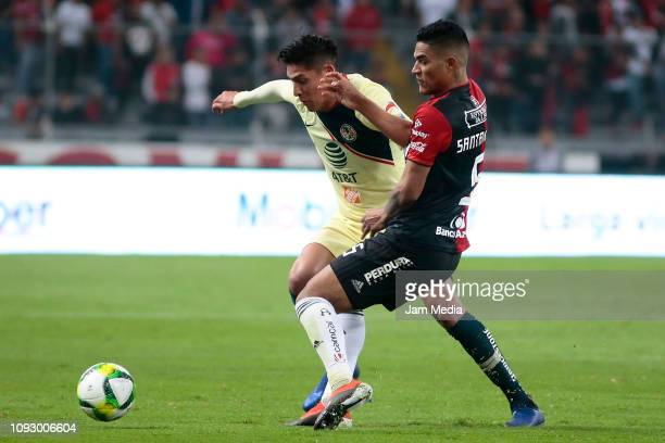 Edson Alvarez of America fights for the ball with Anderson Santamaria of Atlas during the 2nd round match between Atlas and America as part of the...